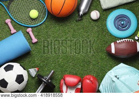 Frame Of Sports Equipment On Green Grass, Flat Lay. Space For Text