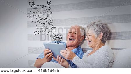 Drawing composition of clouds, online shopping icons, over senior caucasian couple using tablet. global technology, data processing and digital interface concept digitally generated image.