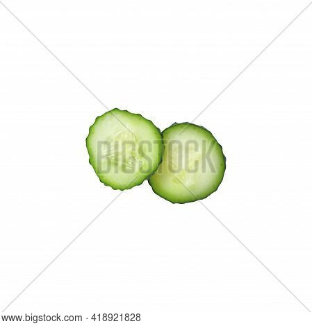 Two Sliced Organic Cucumber Slices Isolated On A White Background. Concept Of Freshness, Juiciness.