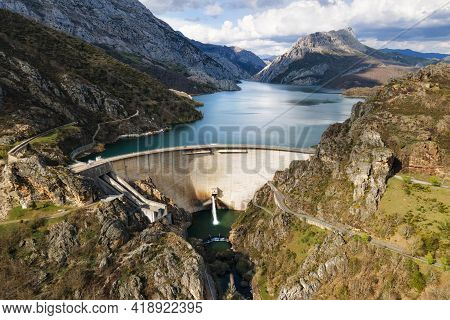 Aerial View Of Water Dam And Reservoir Lake, Generating Hydro Electricity Power Renewable Energy And