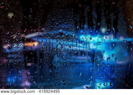 Night City Life Through Windshield. Cars, Lights And Rain, Vintage Style Photography. City View Thro