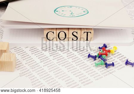 Cost, Expense Or Company Profit And Loss Concept, Cube Wooden Blocks With Alphabet Combine Word Cost