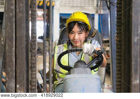 Cute Asian Engineer Worker Women Driving Forklift In Factory-warehouse