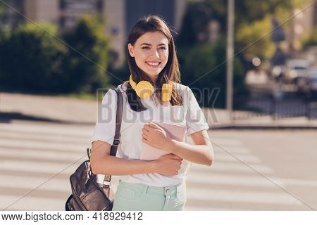 Photo Portrait Of Girl Keeping Book Wearing Rucksack Yellow Headphones Smiling Going To College