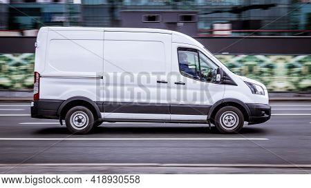 Ford Transit Fourth Generation In The City Street. Side View Of White Light Commercial Vehicle. Mosc