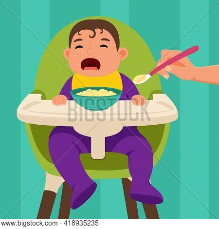The Baby Sits In The Feeding Chair And Refuses To Eat When He Is Being Fed.