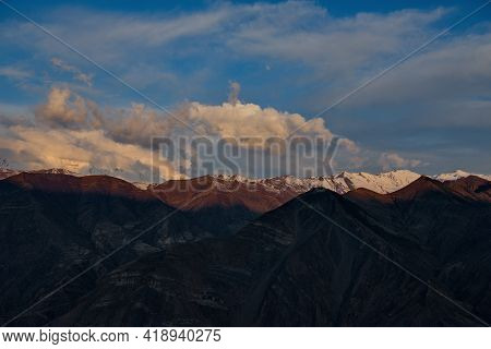 Russia. North-eastern Caucasus, Republic Of Dagestan. Shrouded In Clouds And Illuminated By The Morn