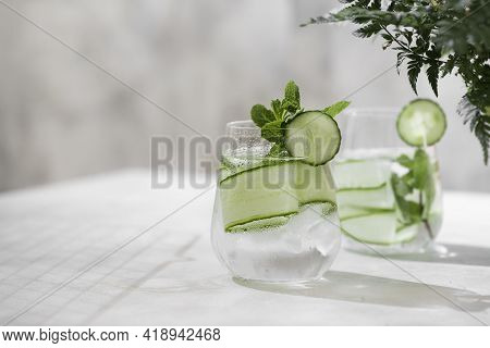 Detox Cocktail Cucumber And Mint On A Light Background. Healthy Nutrition Diet Concept. Homemade Lem