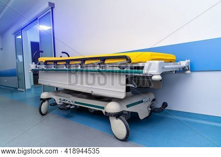 New Modern Trolley Or Cart For Patients In Hospital Corridor. Up-to-date Cart. Blue And White Toning