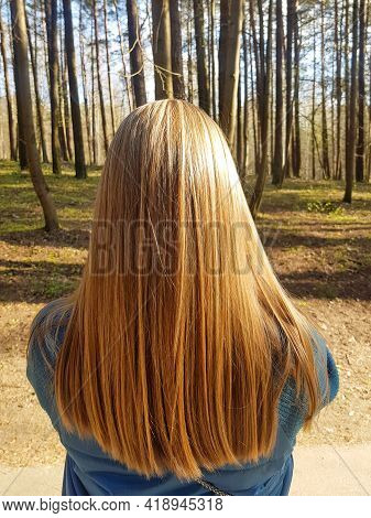 A Rearview Shot Of A Beautiful Young Woman\'s Long Red Hair. Rear View Of A Red-haired Girl