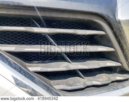 Elements Of The Car Radiator Grille Close-up. Black Radiator Grille