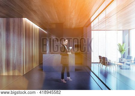 Woman At Corporate Kitchen Room With Furniture And Panoramic Window, Lens Flare. Businesswoman Drink