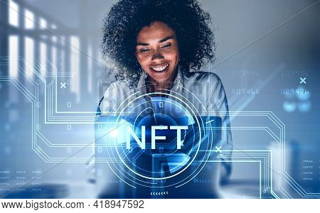Attractive African American Businesswoman Working On Laptop, Non-fungible Token Hologram, Nft With N
