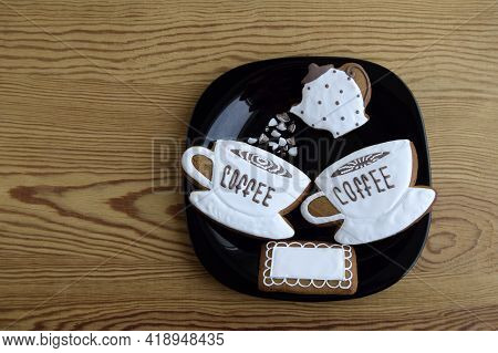 Gingerbreads In The Form Of Cups With Coffee, Napkin And  Coffee Pot. Gingerbread Is On A Black Plat