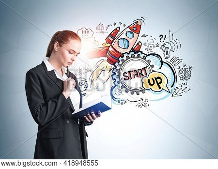 Office Woman Standing Reading Notebook, Pensive Look. Rocket Start Up Icons On Blue Wall, Launch Of