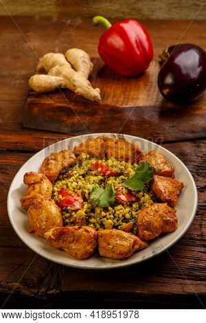 Food For Suhoor In Ramadan Bulgur Post With Beef In A Plate On A Wooden Table Next To Vegetables On