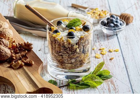 Delicious Dessert Of Blueberries, Yogurt And Cereals (muesli). Refreshing And Healthy Breakfast Of Y