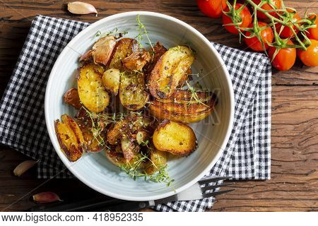 Appetizing Stew Of Pork Tenderloin Meat Cooked In The Wok, Cut Into Cubes. With Roasted And Golden P