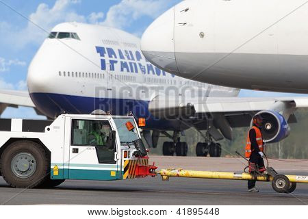 MOSCOW - SEP 01 : Aircrafts and workers of airdrome at airport Domodedovo, Sep 01, 2011, Moscow, Russia. Domodedovo - largest airport in Russia and Eastern Europe in terms of passenger traffic.