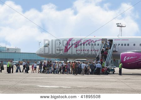 MOSCOW - SEP 01 : Passengers at boarding to plane of Vim Avia airline, Sep 01, 2011, Moscow, Russia. Airline VIM-AVIA was created by General Director of company Aerofraht V. Merkulov in October 2002.