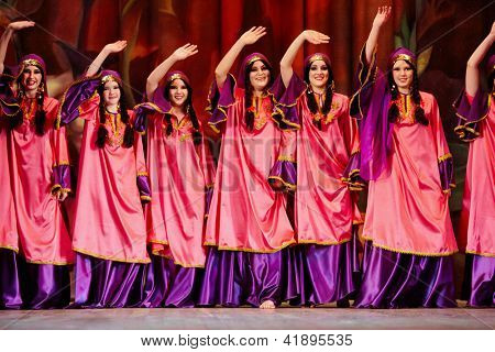 MOSCOW - JAN 28: Women dancing collective dressed in oriental dress  on stage of Red October Culture Palace during Bellydance Superiority of Moscow, Jan 28, 2012, Moscow, Russia.