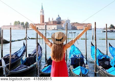 Holidays In Venice. Back View Of Beautiful Girl With Raised Arms Up Enjoying View Of Venice Lagoon W