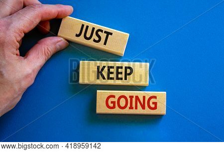 Just Keep Going Symbol. Wooden Blocks With Words 'just Keep Going'. Beautiful Blue Background, Busin