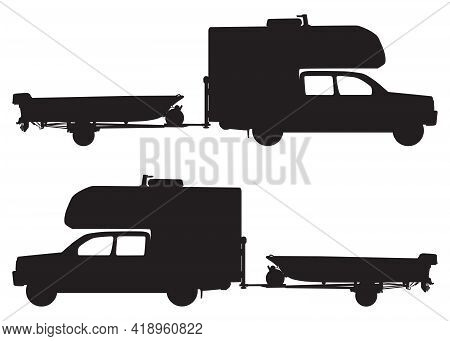 A Pickup With A Camper On Top Is Towing A Fishing Boat