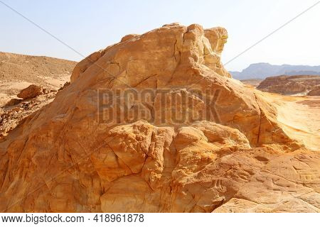 The Texture Of Mountain Slopes And Landscapes In The Judean Desert In Southern Israel. A Hot Sunny D