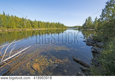 Clear Waters Under A Clear Sky On The Kekekabic Ponds In The Boundary Waters In Minnesota