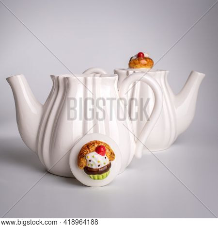 Handmade Teapot For Brewing Tea. Porcelain Teapot. White Ceramic Tableware On A White Background Clo