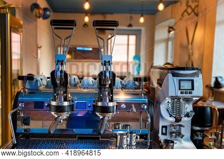 Close Up Of Wood And Still Lever Espresso Machine