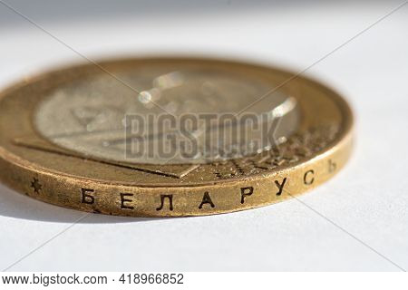 Belarusian Money On A White Background. Belarusian Coin In Macro In Denominations Of Two Rubles With