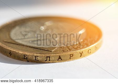 Belarusian Money On A White Background With Flare. Belarusian Coin In Macro In Denominations Of Two