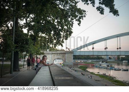 Szeged, Hungary - July 21, 2017: Selective Blur On A Woman Smoking A Cigarette With A Blur On Belvar