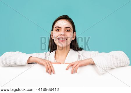 Woman Apply Facial Cream. Beauty Portrait Of Beautiful Female Model With Facial Mask Cream, Isolated