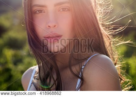 Portrait Of Beautiful Model With Natural Nude Make Up. Beauty Girl Face. Young Sensual Woman Outdoor