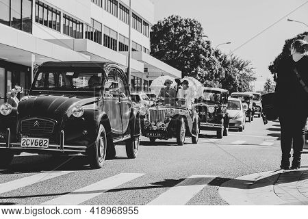 Tauranga New Zealand - April 3 2021; Vintage Car Parade Through City Streets With Red And Black Citr