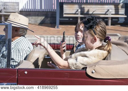Tauranga New Zealand - April 3 2021; Two Young Women Sitting Back Of Convertible Vintage Car Close-u