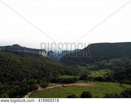 Panorama View Of Stone Rock Cliff Gorge Canyon With Green Grass Meadow Fields Near Tavertet Osona Ba