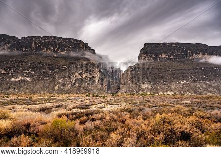 Cloud Smears Across Top Of Santa Elena Canyon In Big Bend National Park