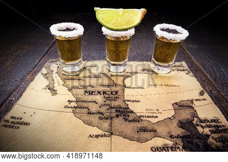 Glass Of Gold Tequila With Old Mexico Map In The Background, Image Celebration Tequila Day