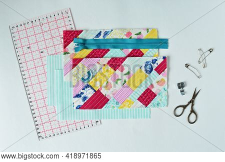 Working Process: Colorful Quilt, Fabric, Zipper, Embroidery Scissors , Quilting Pins, Sewing Foot An