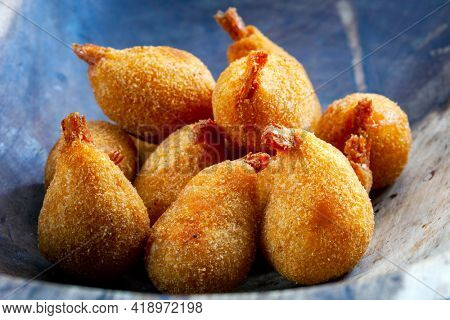 Delicious shrimp croquette served with sauce in Brazil called (coxinha de camarao)