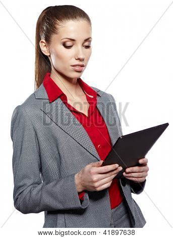 Businesswoman standing with electronic pad