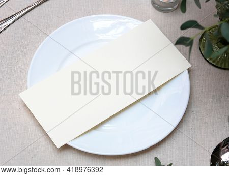Mockup White Blank Space Card, For Menu, Flyer, Greeting, Invitation On Wedding Table Setting Backgr
