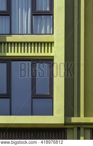 Sunlight On Glass Windows Surface Of Green Modern Building In Vertical Frame