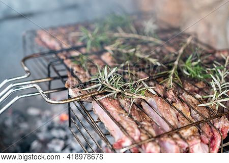 Lamb Ribs Cooked Over An Open Fire, Close-up. Lamb Chops Grilling Barbecue, Bbq Originally Made From