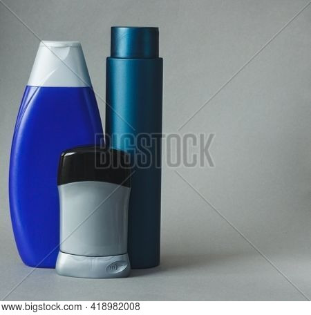 Cosmetic For Men In Bottle On Gray Background. Basic Skin Care Cosmetic Products And Accessories For