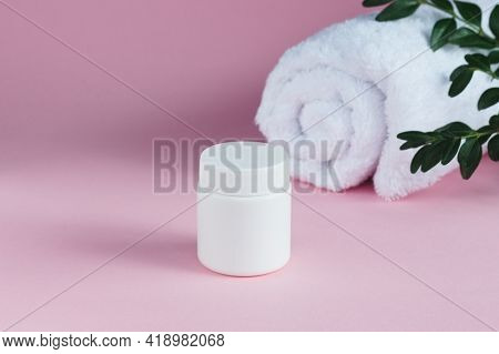 Bottles, Tubes, Jar Of Cream Or Lotion With White Towel On Pink Background. Organic, Eco Cosmetics.